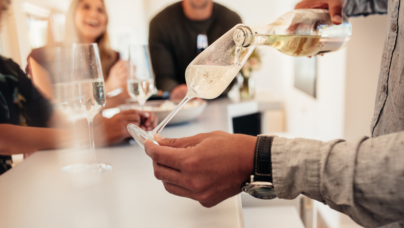 Man serving a wines to friends