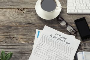 Mortgage application form on wooden table