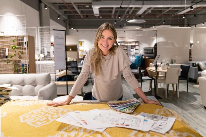 Interior designer working on home design at a furniture store