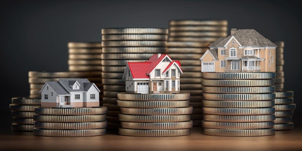 Miniature houses on top of coins