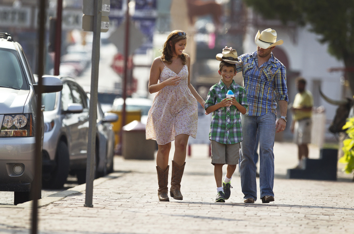 happy family walking on one of the top cities in Texas